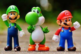 focus photo of super mario luigi and yoshi figurines