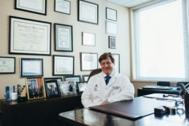 doctor sitting in front of his desk