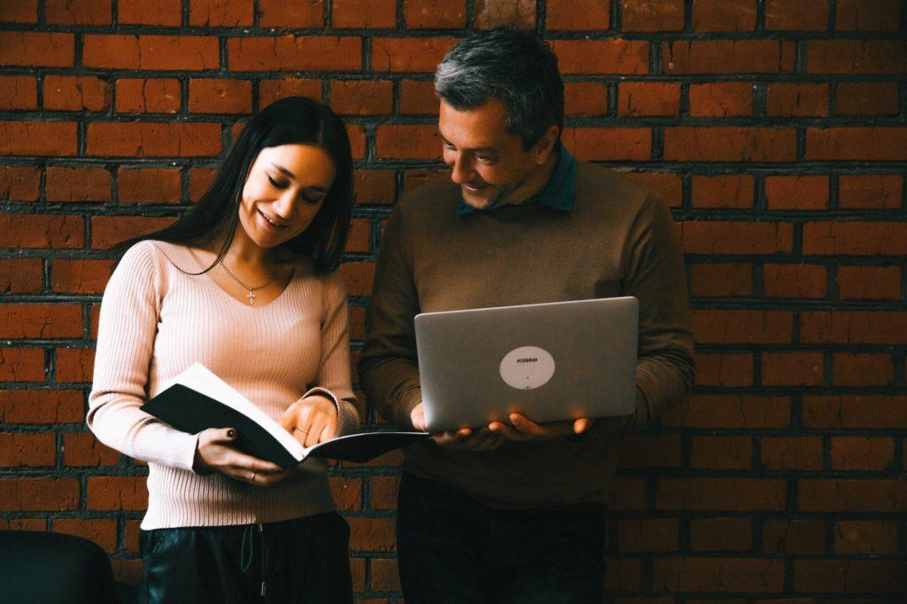 man and woman looking at notes